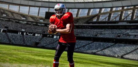 American Football Player against rugby stadium on a sunny day 스톡 콘텐츠
