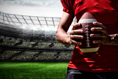 American Football Player against rugby stadium
