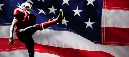 American Football Player against close-up of an american flag 스톡 콘텐츠