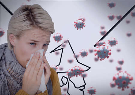 Composition of covid 19 cells and sick woman blowing her nose. global coronavirus pandemic and health concept digitally generated image.