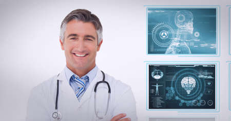 Portrait of caucasian male doctor smiling against screens of medical data processing. medical research and technology concept Standard-Bild