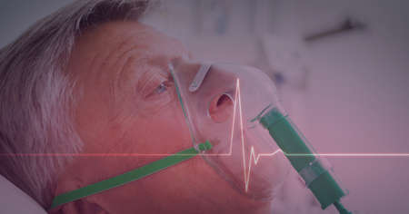 Heart rate monitor against male senior patient wearing oxygen mask. medical research and technology concept Standard-Bild