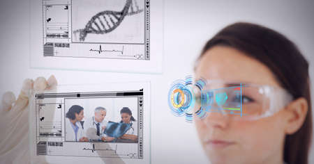 Medical data processing against female health worker wearing protective glasses. medical research and technology concept
