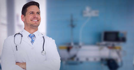 Portrait of caucasian male doctor wearing lab coat smiling at hospital. healthcare and professionalism concept