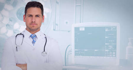 Portrait of caucasian male doctor with arms crossed standing at hospital. healthcare and professionalism concept standing