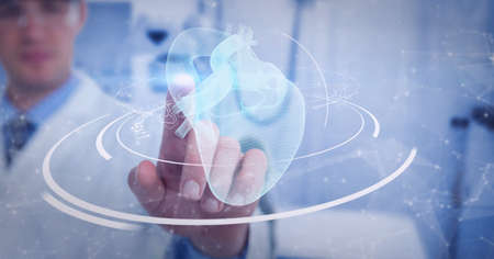 Mid section of male doctor touching screen with human heart icon and medical data processing. medical research and technology concept