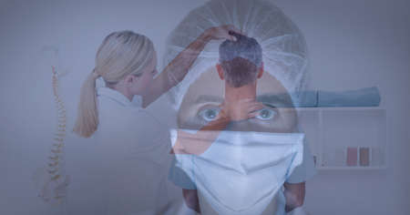 Portrait of female health worker wearing face mask against female doctor doing neck adjustment. healthcare and professionalism concept standing