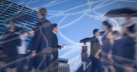 Network of connections against business people walking against tall buildings. global business and networking technology concept