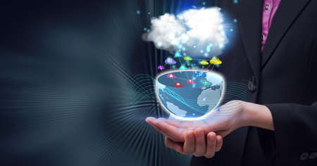 Composition of network of digital icons with globe and cloud over hands of businessman. global technology and digital interface concept digitally generated image.