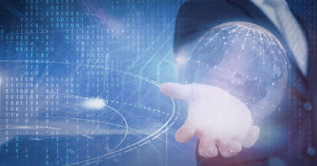 Composition of binary coding and network of digital icons forming globe over hand of businessman. global technology and digital interface concept digitally generated image.
