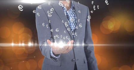 Composition of network of digital euro currency icons over hand of businessman. global technology and digital interface concept digitally generated image.