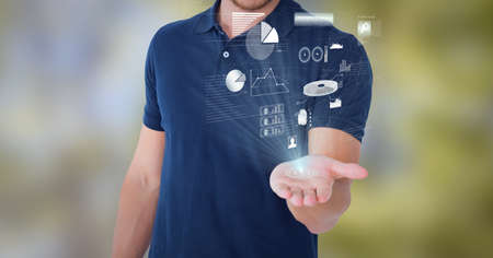 Composition of network of digital icons and statistics over hand of businessman. global technology and digital interface concept digitally generated image. Standard-Bild