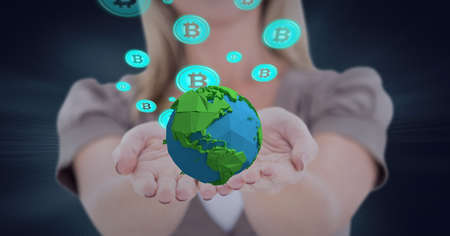 Composition of network of digital bitcoin icons with globe over hand of businesswoman. global technology and digital interface concept digitally generated image.