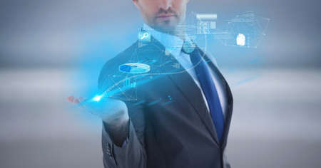 Composition of network of digital icons and data processing over hand of businessman. global technology and digital interface concept digitally generated image. Standard-Bild