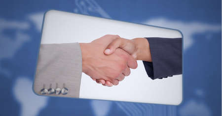 Composition of businessman and businesswoman shaking hands on digital tablet screen. global business, finances and networking concept digitally generated image.