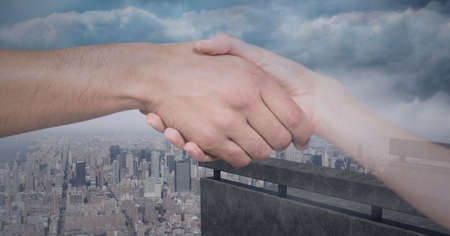 Composition of businessman and businesswoman shaking hands with cityscape. global finance, business and connection concept digitally generated image.