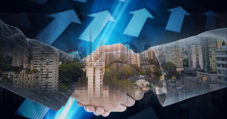 Composition of businessmen shaking hands with blue arrows and cityscape. global finance, business and connection concept digitally generated image. Standard-Bild