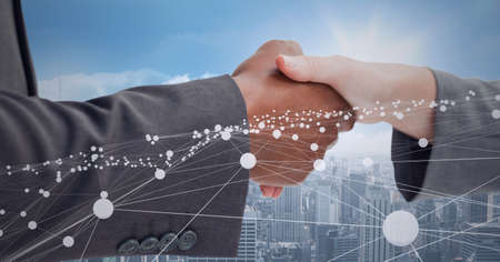 Animation of network of connections and cityscape over businessman and businesswoman shaking hands. global finance, business and connection concept digitally generated image. Standard-Bild