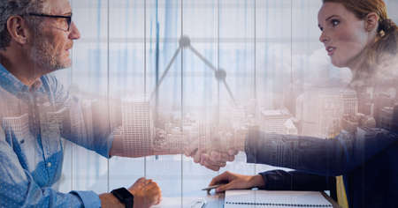 Composition of businessman and businesswoman shaking hands with statistics recording and cityscape. global finance, business and connection concept digitally generated image.