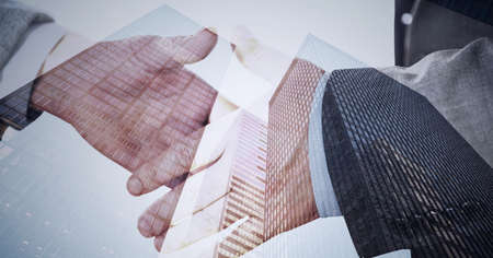 Composition of businessmen shaking hands with modern office buildings. global finance, business and connection concept digitally generated image. Standard-Bild