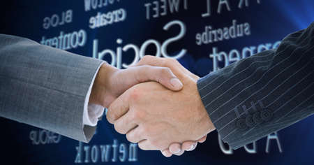 Composition of businessman and businesswoman shaking hands over financial and business text. global finance, business and connection concept digitally generated image.