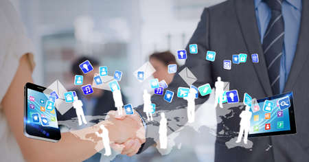 Composition of businessmen shaking hands with digital icons. global finance, business and connection concept digitally generated image.