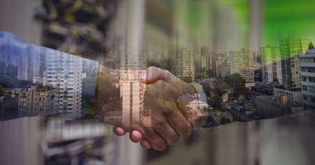 Composition of businessmen shaking hands with cityscape. global finance, business and connection concept digitally generated image. Standard-Bild