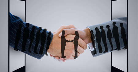 Composition of businessmen handshake with silhouettes of people shaking hands. global finance, business and connection concept digitally generated image.