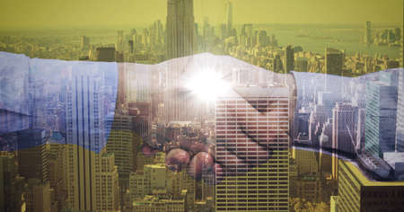 Composition of businessmen shaking hands with glow over cityscape. global finance, business and connection concept digitally generated image. Standard-Bild
