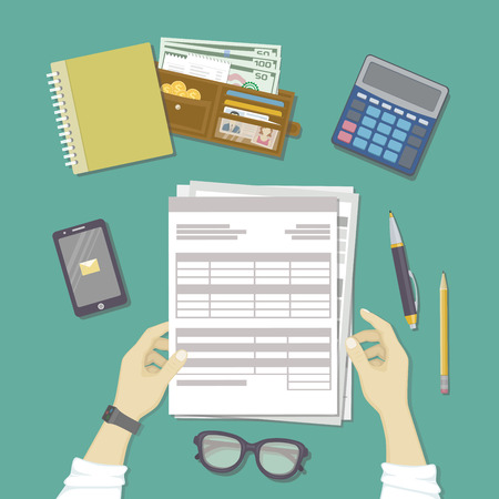 tax form: Man working with documents. Human hands hold the accounts, payroll, tax form. Workplace with papers, blanks, forms, phone with message, smart watches, wallet with money, credit cards. Top view Vector