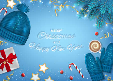 Merry Christmas and Happy New Year Greeting card. Winter Elements fir branches, knitted blue hat, mittens, cocoa cup, paper gift box, sweets, garlands, ribbons on blue background. Top View Vector