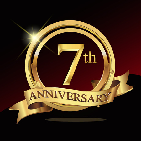 7th years golden anniversary logo celebration with ring and ribbon.