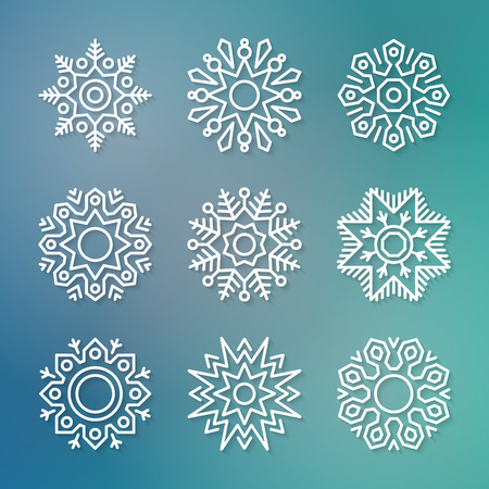 paper graphic: Set of flat line vector paper snowflakes with shadows on blue blurred background. Christmas and New Year decoration element. Simple shape template for graphic design