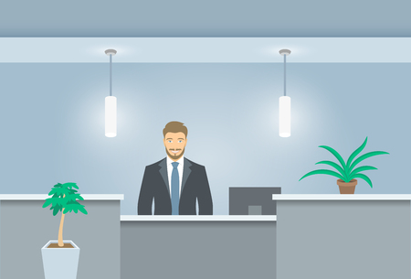 Young man receptionist stands at reception desk Stock Illustratie