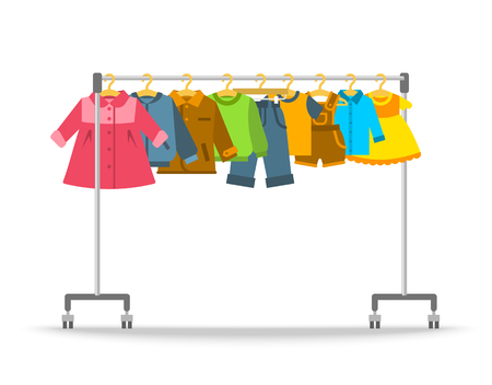 Kids clothes on hanger rack. Flat style vector illustration. Casual little kids apparel hanging on shop rolling display stand. Boys and girls outfit fashion collection. Children store sale concept Vettoriali