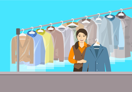 Dry cleaning shop interior. Asian girl stands at reception counter and holds clean jacket. Hanging rack with cleaned clothes. Vector flat illustration. Textile cleaner service conceptual background Reklamní fotografie - 102752906