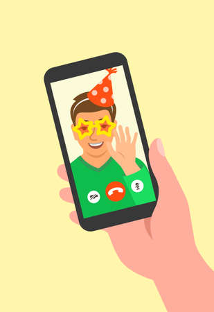 Virtual party celebration together with friend video call. Young boy in party hat and funny glasses waving hand and congratulates his friend using smartphone. Stay home cartoon vector illustration 向量圖像