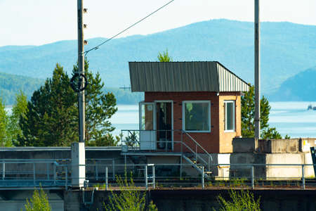 Checkpoint at the top of the hydroelectric power station. Small building for security personnel.