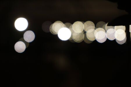 Beautiful Abstract circular bokeh background. Blurry bulb in nightlife darkness
