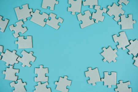 random white jigsaw puzzle incomplete concept on blue background