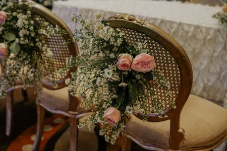 Flower bouquet focus hanging on chair Declaration and promise wedding ceremony stage decoration Banco de Imagens