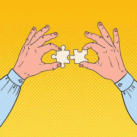 2つのパズルピースを保持するポップアート男性の手。ビジネス ソリューションの概念。