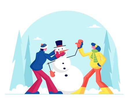 Young Man and Woman in Warm Clothing Making Funny Snowman on Snowy Landscape Background. Winter Time Outdoor