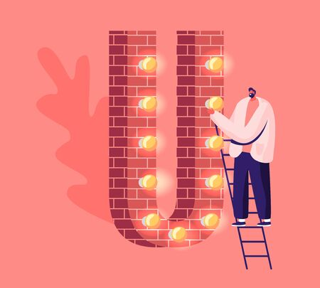 Adult Cheerful Man Stand on Ladder at Huge Letter U Made of Red Bricks Decorated with Lighting Garland and Glowing Lamps