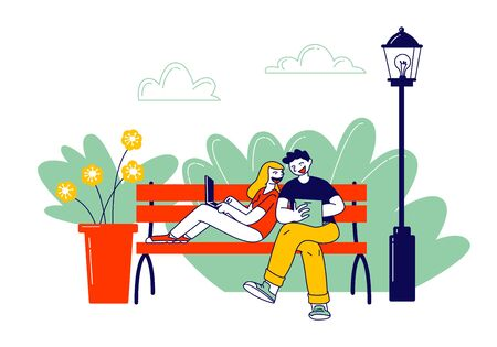 Remote Freelance Work, Selfemployment Concept. Man and Woman Freelancers Sitting in City Park Working Distant on Laptop