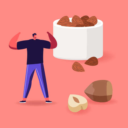 Man Fitness Workout with Hazelnuts around. Source of Protein, Vegetarian Nutrition Products, Healthy Vegan Food Dieting