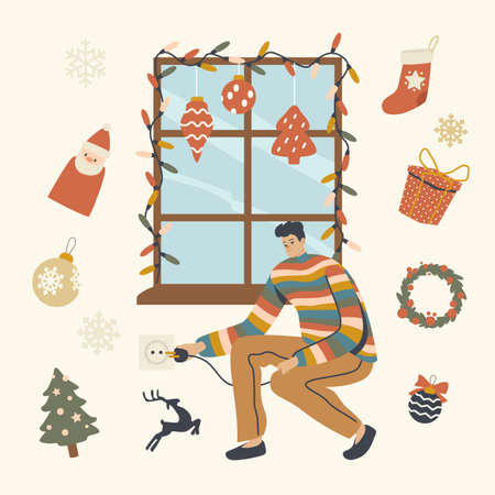Man Decorating Window with Christmas Decor Switch On Garland, Hanging Balls, Socks and Fir Tree Branches, Xmas Season