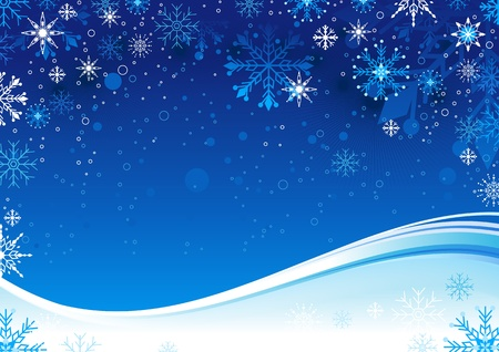 Blue Christmas background with snowflakes and copy space.