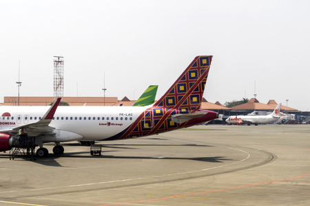 JAKARTA, INDONESIA - AUGUST 16, 2017 : The Batik Air Airbus A320-200 Docked at Terminal One and Ground Staff Check Aircraft Wing in Soekarno Hatta International Airport Jakarta. Batik Air is part of Lion Group.