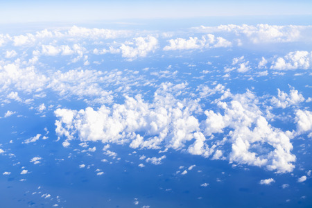 aerial view of beautiful blue sky and clouds shoot from airplane window in summer season Stock Photo